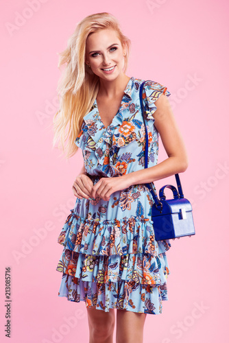 Beautiful Fashionable Blonde Woman In Nice Blue Dress With Flowers