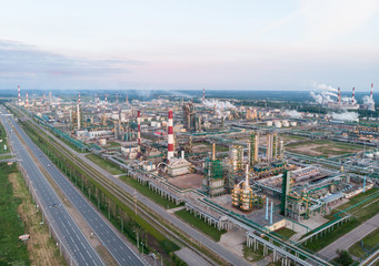 Oil refinery plant industry, Refinery factory, oil storage tank and pipeline steel with sunrise and cloudy sky background, Russia