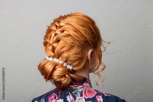 A Womans Hairstyle Is A Low Bun On A Red Haired Girl Back View On A