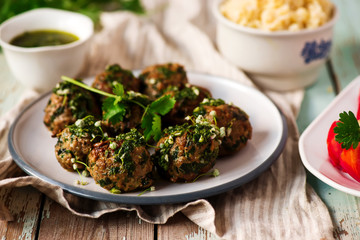 Chimichurri Whole Meatballs with Swiss Chard.