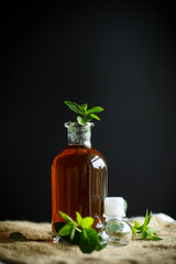 Mint syrup in a glass bottle