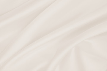 Smooth elegant golden silk or satin luxury cloth texture as wedding background. Luxurious background design. In Sepia toned. Retro style