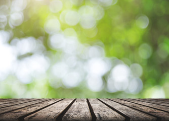 Empty Wood Table for Montage Display Product with Nature Bokeh Background