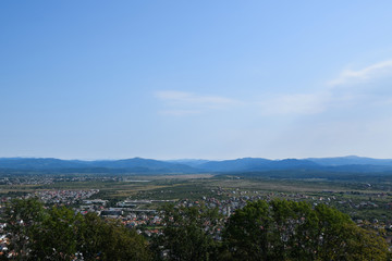 Panorama of Khust city in Zakarpattia Oblast. View from ruin of old castle. Landscape, Ukraine.