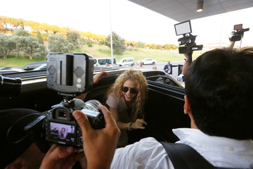Colombian singer Shakira reacts upon her arrival with her kids at the airport in Beirut