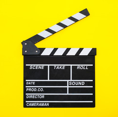 movie clapper on a yellow background