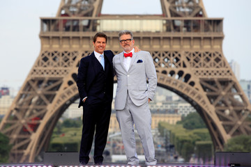 "Director Christopher McQuarrie and cast member Tom Cruise pose in front the Eiffel Tower during the world premiere of the film ""Mission: Impossible - Fallout"" in Paris"