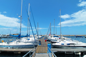 White yachts lined up at the dock