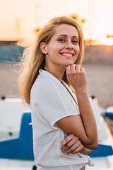 Flexible energetic woman posing on beach