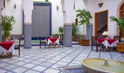 Courtyard decorated with mosaic and carvings in a Moroccan riad