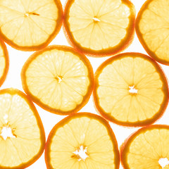 Illuminated orange slices isolated on white background