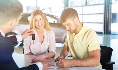 Couple with car dealer