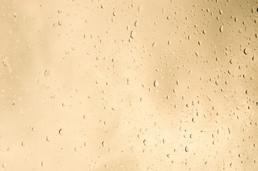 Raindrops yellow gold background