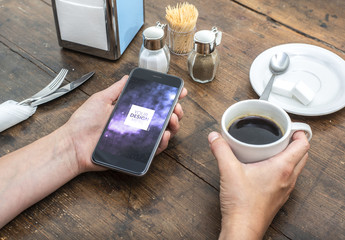 Smartphone User Holding Coffee Cup Mockup