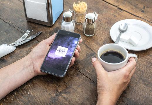 Smartphone User Holding Coffee Cup Mockup