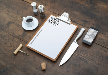 Restaurant Menu and Smartphone on Wooden Table Mockup
