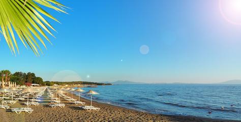 Turkey Aegean Sea coast. sunbeds and umbrellas on the beach