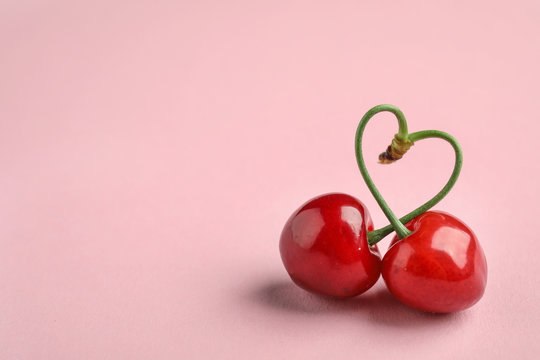 Sweet red cherries on color background