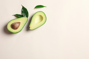 Ripe sliced avocado on light background