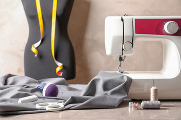 Sewing machine, fabric and accessories for tailoring on table