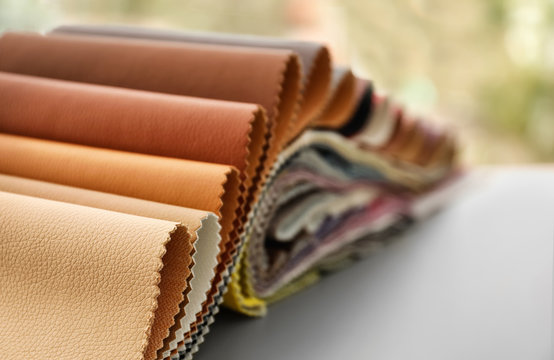 Leather samples of different colors for interior design on table