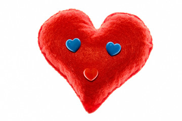 Soft red heart. Emotion with blue eyes. A symbol of love and happiness. Close-up. White background.
