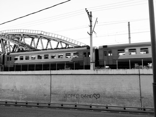 A subway train on the Moscow races over a bridge on the Han River.
