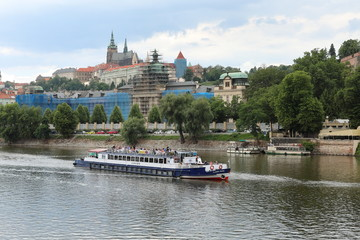 Striking view from the Charles Bridge to the Vltava river, old architecture and modernity