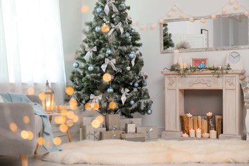 Foto op Canvas Kerstmis Stylish living room interior with decorated Christmas tree and blurred lights in foreground