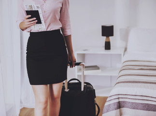 Businesswoman with Passport and Ticket in Hand.