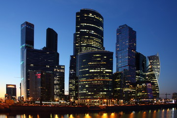 Central business center Moscow City - view of the skyscrapers of the Moscow river on the background of the evening downtown, modern architecture of Russia, night summer urban cityscape