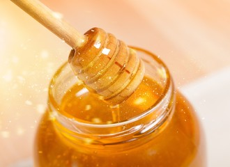 Honey and wooden spoon
