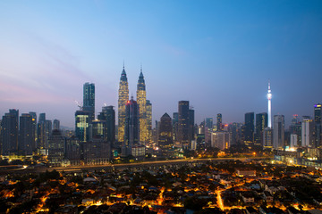 Kuala lumpur cityscape. Panoramic view of Kuala Lumpur city skyline during sunrise viewing skyscrapers building and Petronas twin tower in Malaysia.