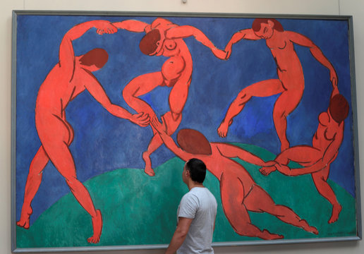 A visitor looks at the French artist Henri Matisse's 'The Dance' at the State Hermitage Museum in St. Petersburg