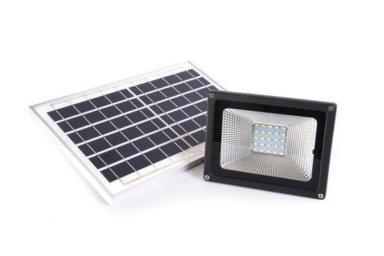 Small solar panel and spotlight for home on white background.