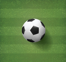 Soccer football ball on green grass field pattern and texture background. Vector.