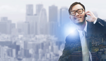 Man using mobile phone with modern city background