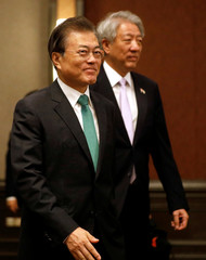 South Korea's President Moon Jae-in arrives with Singapore's Deputy Prime Minister Teo Chee Hean to speak at the ISEAS 42nd Singapore Lecture in Singapore
