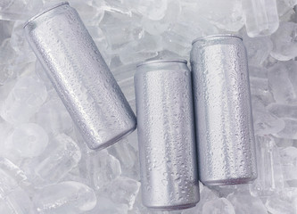 Aluminum beverage drink can in ice isolated on white background. Metal color for your design..