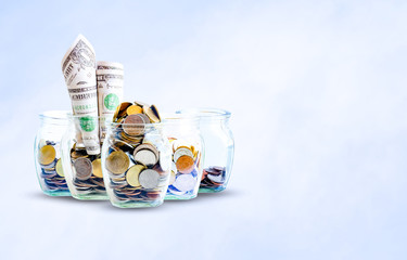 The coins in bottle on white background. save money for future. The concept of growth for the save money.