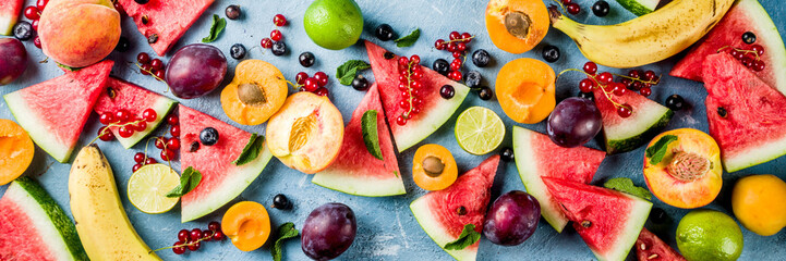Photo sur Plexiglas Fruit Summer vitamin food concept, various fruit and berries watermelon peach mint plum apricots blueberry currant, creative flat lay on light blue background top view copy space