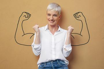 Blond Frau an der Wand / Muskeln / Kraft / Power Wall mural