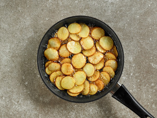frying potatoes in a pan