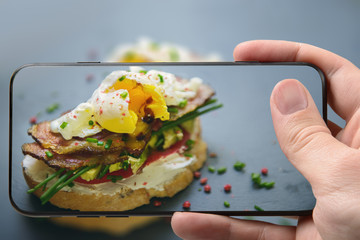 Sandwich with egg poached, bacon and avocado - smartphone photo