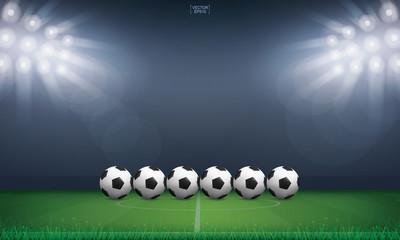 Soccer football ball on green grass of soccer field or football field stadium background. Vector.