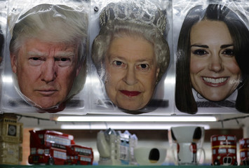 Tourist souvenir masks portraying U.S. President Donald Trump, and members of Britain's royal family are displayed in a tourist shop, during the visit by Trump and First Lady Melania Trump in London