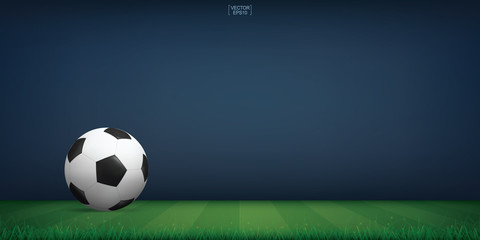 Soccer football ball on green grass of soccer field or football field stadium background. Vector.