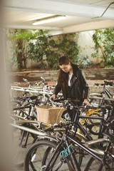 Woman parking her bicycle