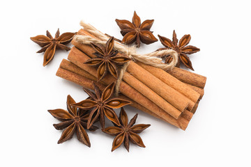 Cinnamon sticks and cardamom on a white background. Aromatic spices.