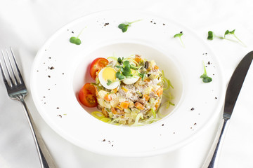 Russian Olivier salad with meat, quail eggs and cherry tomatoes